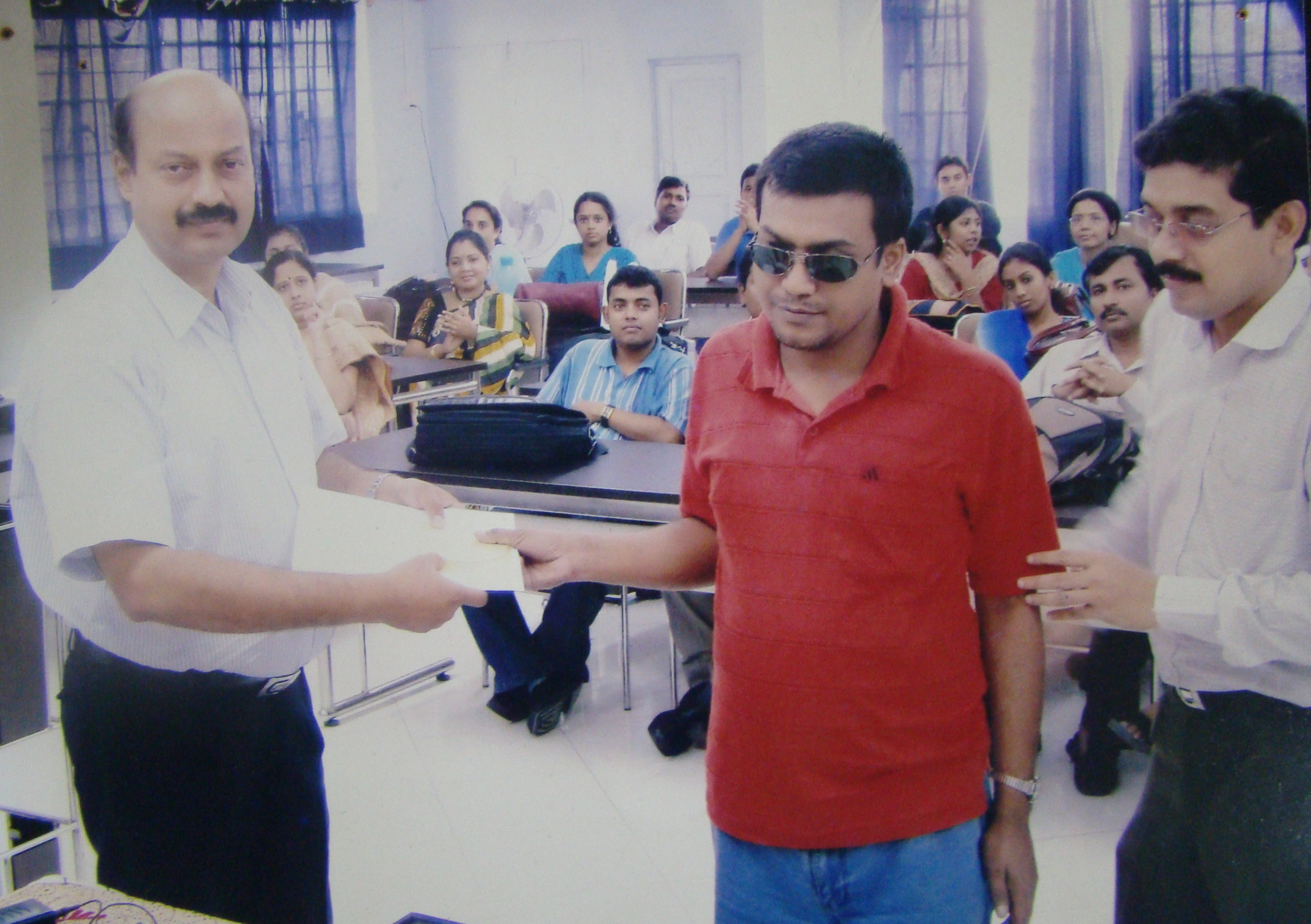 Prof. Ranjan Bhattacharya, giving certificate at OP